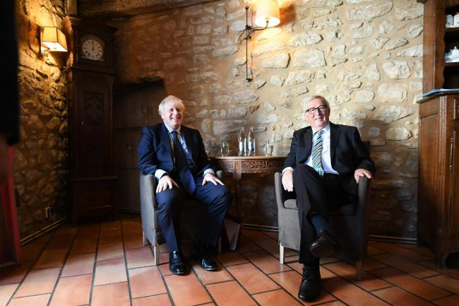 PM Boris Johnson with European Commission president Jean-Claude Juncker inside a restaurant in Luxembourg prior to a working lunch on Brexit