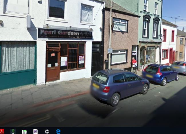 Investigation: Police want to trace the three men who targeted a woman outside this take away (Google Street View)
