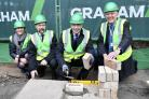 MILESTONE: Carlisle MP John Stevenson, centre, laid the first brick of the new cancer centre at the Cumberland Infirmary                     Pictures: Stuart Walker
