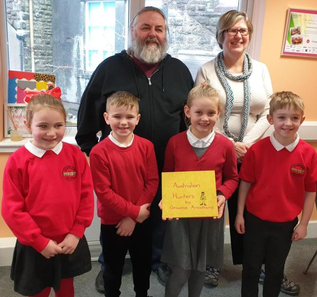n Author Graeme Armstrong donated the book to Dearham School pupils, Chloe, Elliot, Molly and Charlie and the school's business manager Janet Simpson.