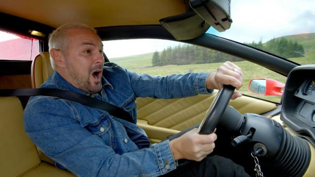 Paddy McGuinness at the wheel of Lamborghini – moments before crashing it in a trailer for the new series (BBC/PA)