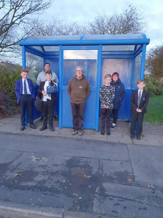 Stagecoach has added a bus in the mornings during term-time through the week at Seaton - Parish Councillor Ken Slone (centre) with residents