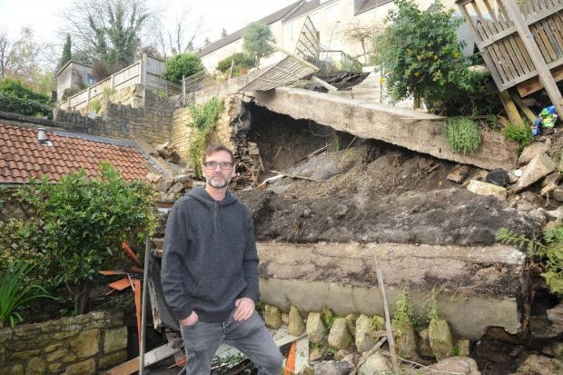 Times and Star: RUBBLE: Damien Weddell at his newly purchased home in Bradford on Avon where his garden wall has collapsed