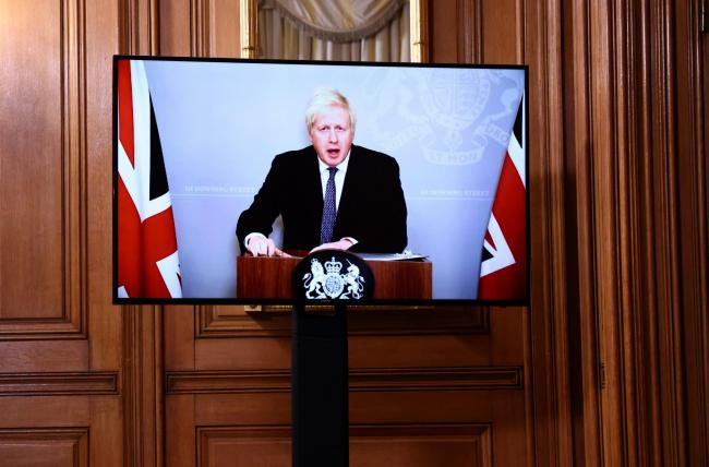 SELF-ISOLATING: Prime Minister Boris Johnson appears via video link