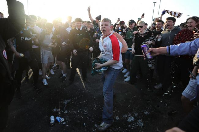 Fans gathered outside Elland Road to protest against a Super League