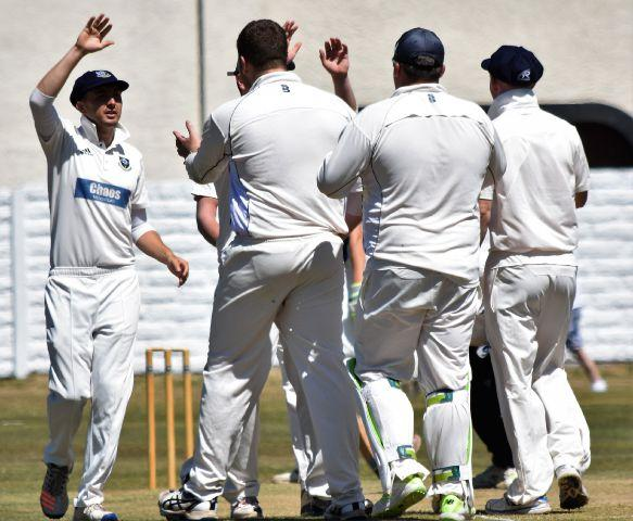 Celebrations: Workington celebrate the wicket of Keswick captain Dan Gaskell (Photo: Ben Challis)