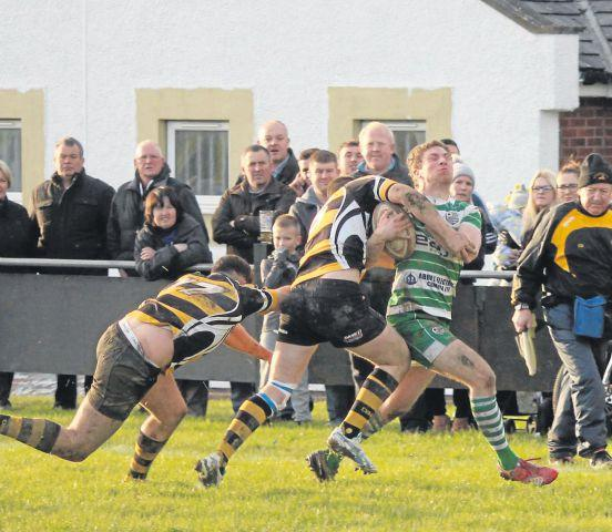 Crunch time: The game saw a number of injuries as Wigton secured a victory over Cockermouth on Saturday