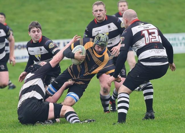 Outnumbered: Egremont's James Temple looks to break free from the Workington defence