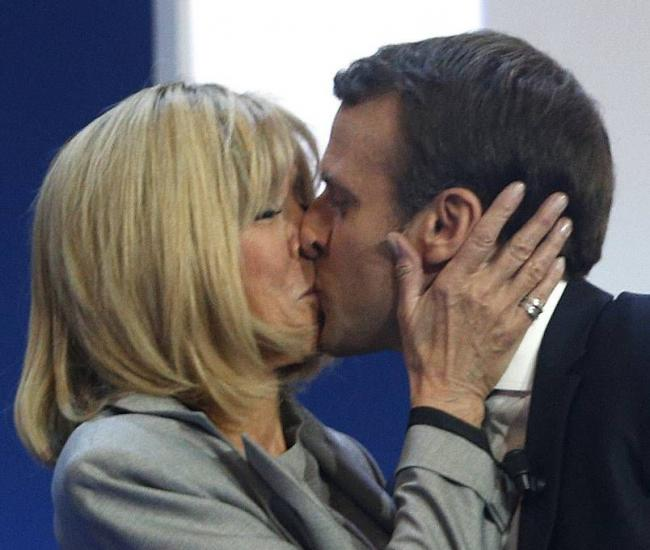 Passionate: French centrist presidential candidate Emmanuel Macron kisses his wife Brigitte
