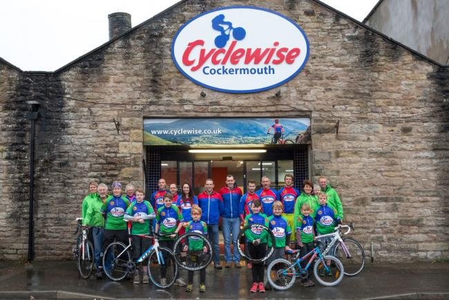 Cyclewise Academy members with Rich Martin, centre right, and Craig Scott, centre left, outside the new shop