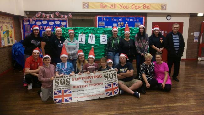 Staff and parents at Ewanrigg Junior School in Maryport helped pack 193 boxes this week to be sent to servicemen and women overseas.