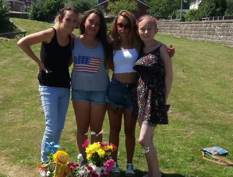 Support: Susan Rumney with her sisters Samantha, Lisa and Sarah at their mother's grave
