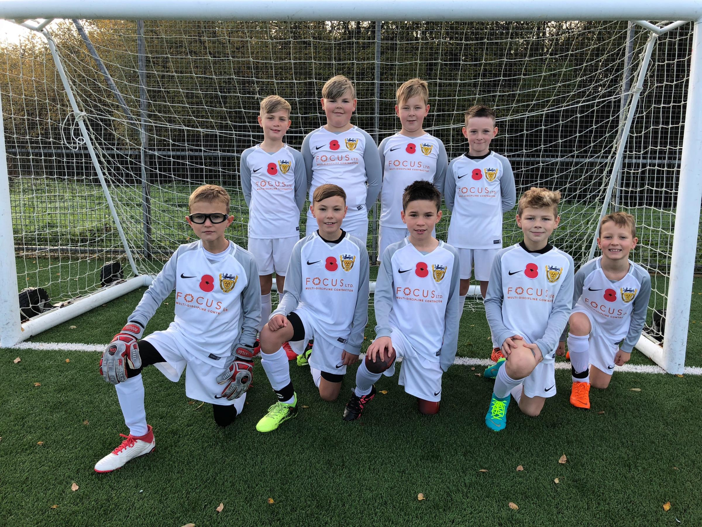Whitehaven AFC Under-10s supporting #poppies4kits in their game against Cockermouth