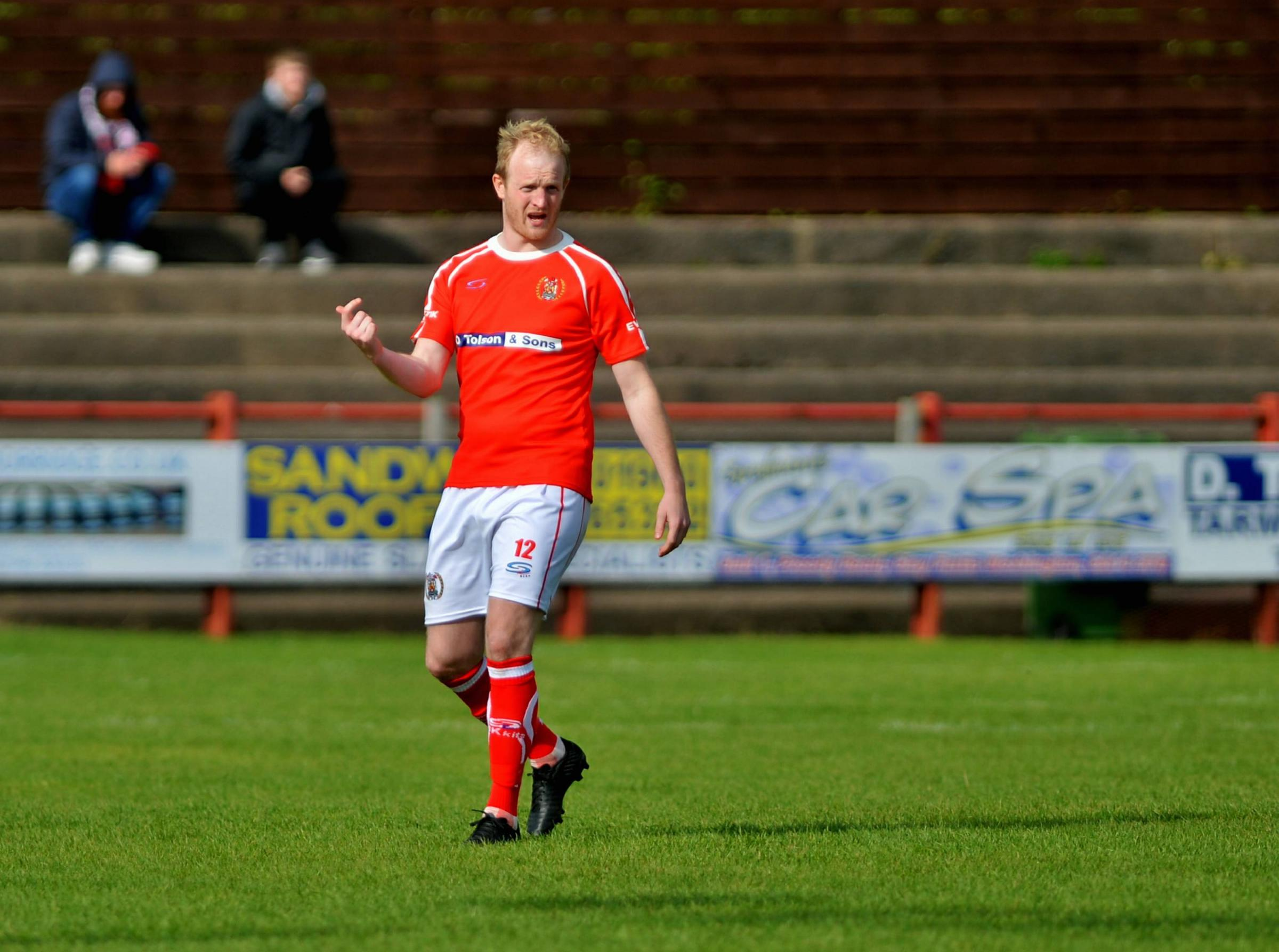 A DOUBT: Reds defender Dan Wordsworth faces a late fitness test ahead of this afternoon's FA Trophy tie