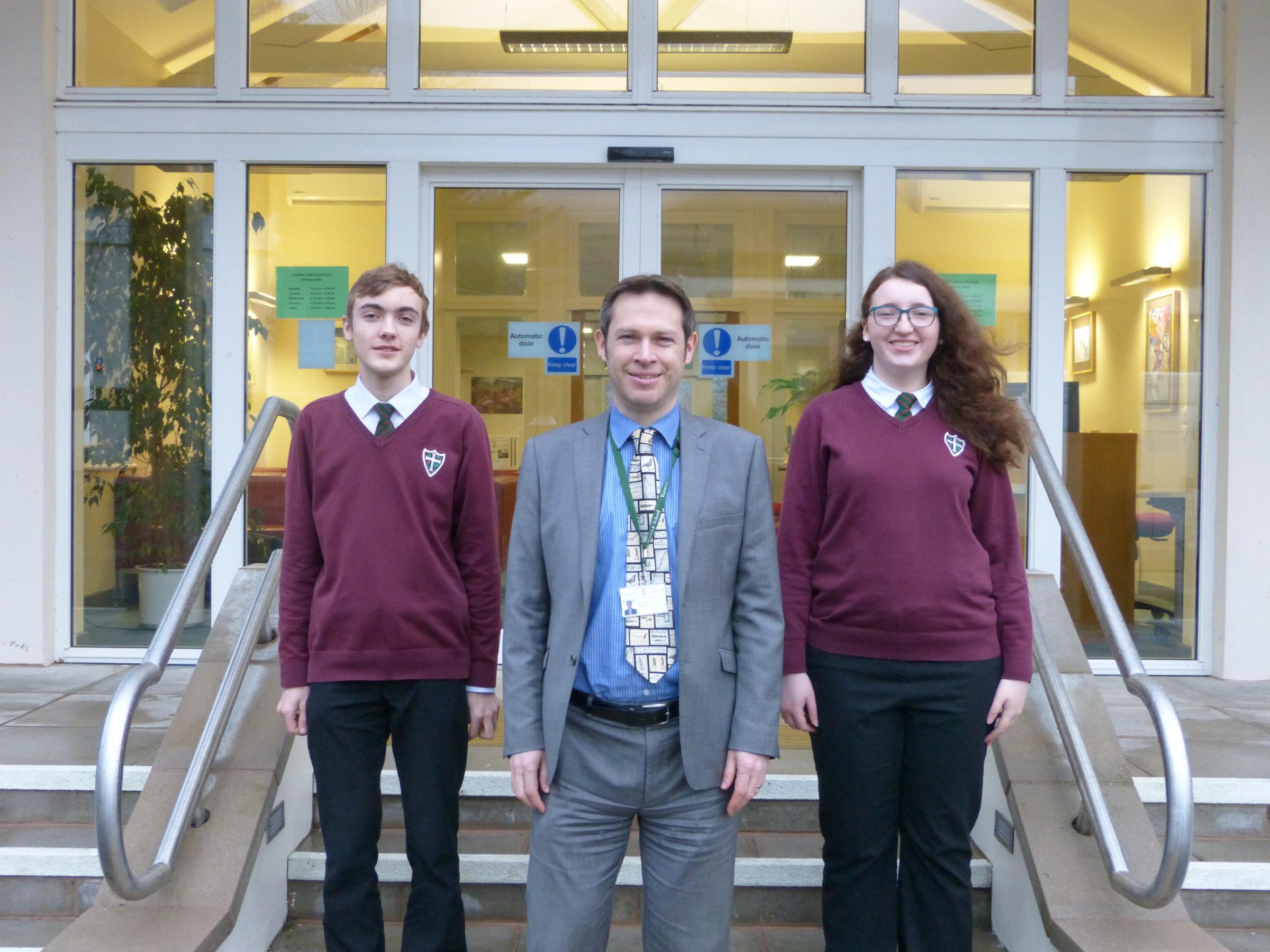 Keswick School pupils Connor Richards and Caitlin McKeever with headteacher Simon Jackson
