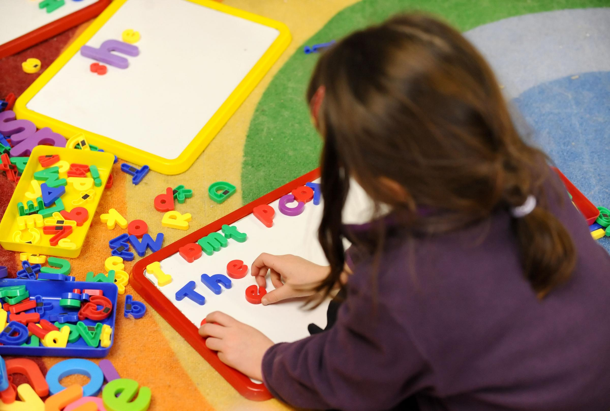 File photo dated 08/02/12 of a primary school child at work in a classroom. Poorer children are already behind in their studies by the time they start school, research in Northern Ireland showed. PRESS ASSOCIATION Photo. Issue date: Friday December 1, 201