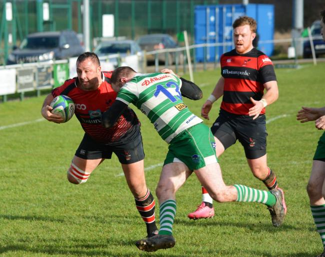 EVASIVE ACTION: Aspatria's Heinie Jonker tries to avoid the Wigton defender. Wigton won the game 27-26                                             Barney Clegg