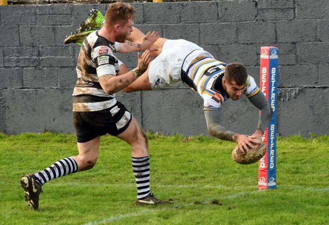 Whitehaven RL v Wigan St Pats....Challenge Cup Whitehaven v Wigan St Pats at the Recreation ground on Sunday March 10th 2019...Whitehavens Andrew Bulman dives over to score.pic John Story.