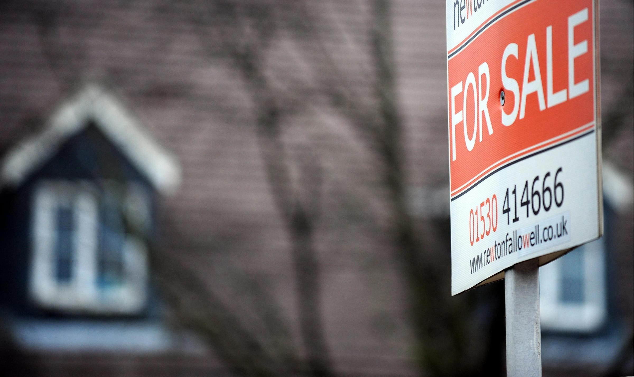File photo dated 28/02/2012 of a general view of for sale sign in Derbyshire as house prices have fallen for the first time in seven months as the number of potential buyers shrinks while the volume of homes going on the market rises, a study said today.