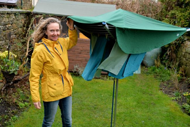 RAINCOAT FOR CLOTHESLINE: Sally Phillips of Chimney Sheep has invented awsay to keep washing dry outside even in the rain... Photo: Tom  Kay