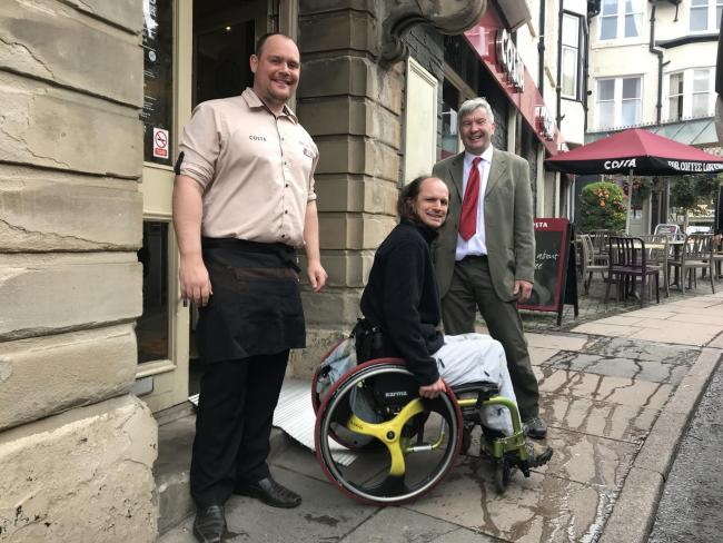 Costa Worker, Keith Watson And Tony Lywood, Labour Parliamentary candidate for Copeland, in accessibility campaign  Picture: John Connell