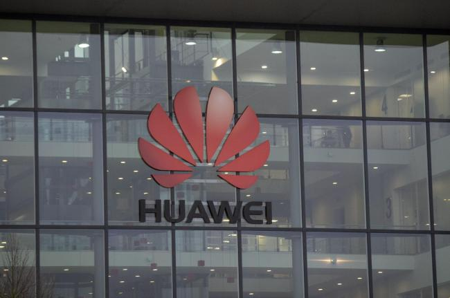 A Huawei sign. The Cambridge-based firm licenses processor designs found in smartphones globally