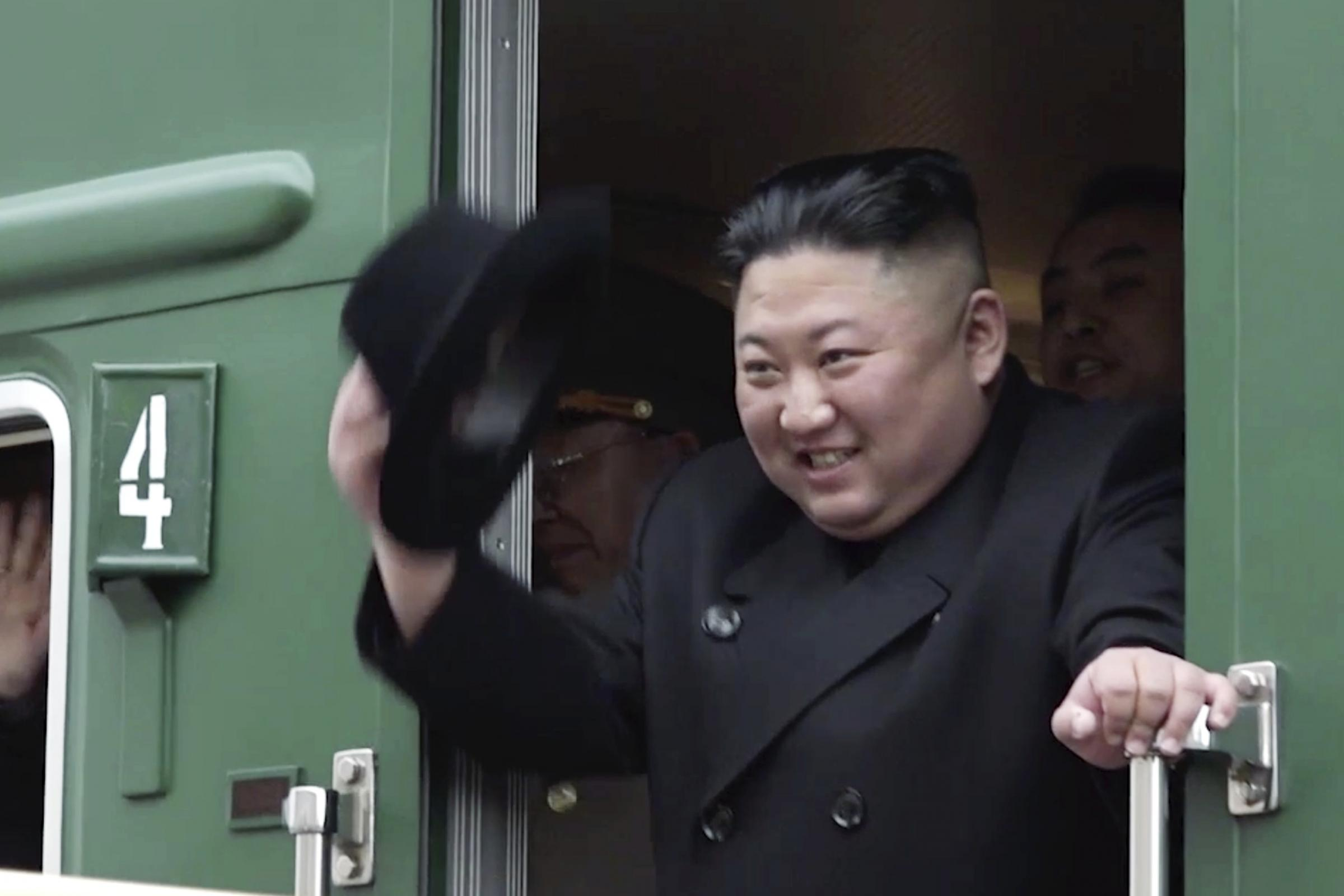 Kim Jong Un boards a train at Khasan station