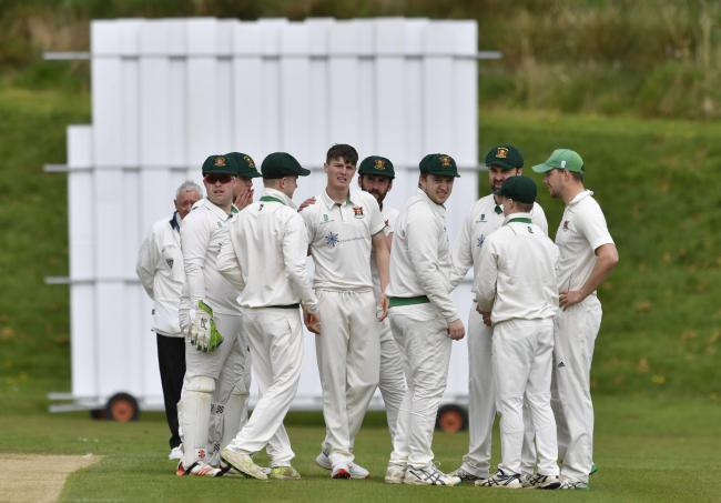 Cricket. Carlisle v Keswick at Edenside, Carlisle. Carlisle team congratulate Michael Slack on taking a wicket: 27 April 2019