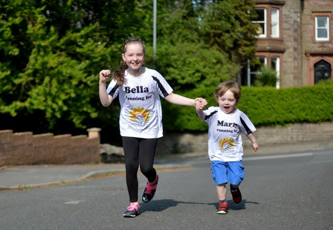 CHARITY: Bella and Marty Gambles from Workington will do the Mini Great Manchester Run on Sunday raising funds for Hospice at Home West Cumbria		  TOM KAY