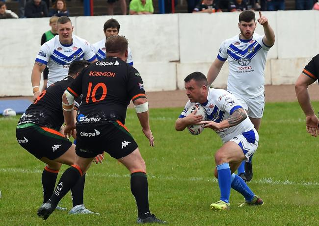 Workington Town v Hunslet May 19th 2019....Workington Town v Hunslet at Derwent Park on Sunday May 19th 2019...Towns Sean Penkywicz takes on the Hunslet line.pic John Story.