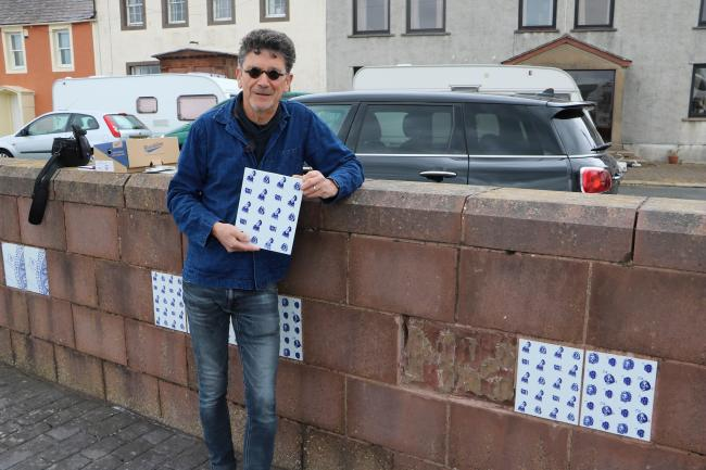 HISTORY: Artist Paul Scott is replacing the damaged harbourside tiles depicting Maryport's past